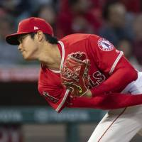 Angels pitcher Shohei Ohtani is sidelined with a sprained ligament in his right elbow. | AP