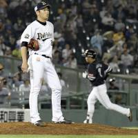 Orix reliever Taisuke Kondo reacts as Fukuoka SoftBank's Akira Nakamura rounds the bases in the 10th inning of Friday's game. | KYODO