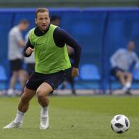 England's Harry Kane looks to pass the ball during a training session at Spartak Zelenogorsk Stadium near St. Petersburg, Russia, on Wednesday. | AP