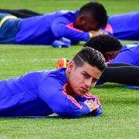 Colombia's James Rodriguez stretches during a training session in Kazan, Russia. | AFP-JIJI