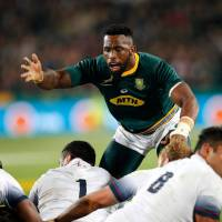 South Africa captain Siya Kolisi defends a ruck during his team's match against England on Saturday in Johannesburg. | AFP-JIJI