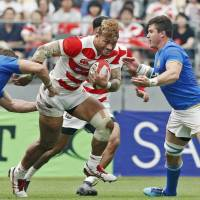 The Brave Blossoms' Amanaki Lelei Mafi, seen in action against Italy last Saturday in Oita, is nursing an ankling injury. | KYODO