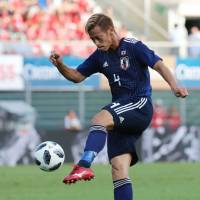 Japan's Keisuke Honda takes a shot on goal during Friday's friendly with Switzerland in Lugano. | AFP-JIJI