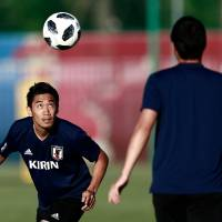 Shinji Kagawa heads the ball at a Japan training session in Kazan, Russia, on Friday. | AFP-JIJI