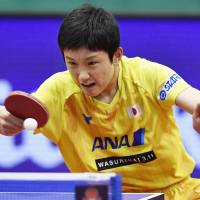 Tomokazu Harimoto competes against two-time Olympic champion Ma Long of China on Saturday in the Japan Open quarterfinals in Kitakyushu. Harimoto won 11-8, 11-9, 11-7, 3-11, 2-11, 11-6. | KYODO