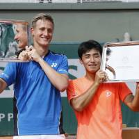 Naoki Tajima (right) and Ondrej Styler celebrate after winning the boys' doubles title at the Roland Garros Junior French Championships on Saturday in Paris. | KYODO