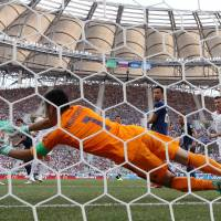 Defeated Japan squeezes into World Cup last 16 thanks to fair play
