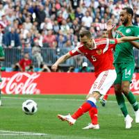 Denis Cheryshev scores Russia's second goal over Saudi Arabia in the opening game Thursday in Moscow. Russia won 5-0. | REUTERS