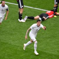Uruguay's Jose Gimenez (right) celebrates after scoring in the 89th minute against Egypt in a World Cup Group A match on Friday in Yekaterinburg, Russia. Uruguay won 1-0. | AFP-JIJI
