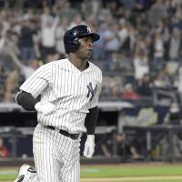 The Yankees' Didi Gregorius rounds the bases after hitting a home run against the Nationals on Tuesday night at Yankee Stadium. | AP