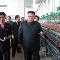 North Korean leader Kim Jong Un tours a factory in Sinuiju, North Korea, in this undated photo released by the North's Korean Central News Agency (KCNA) on Monday. | REUTERS