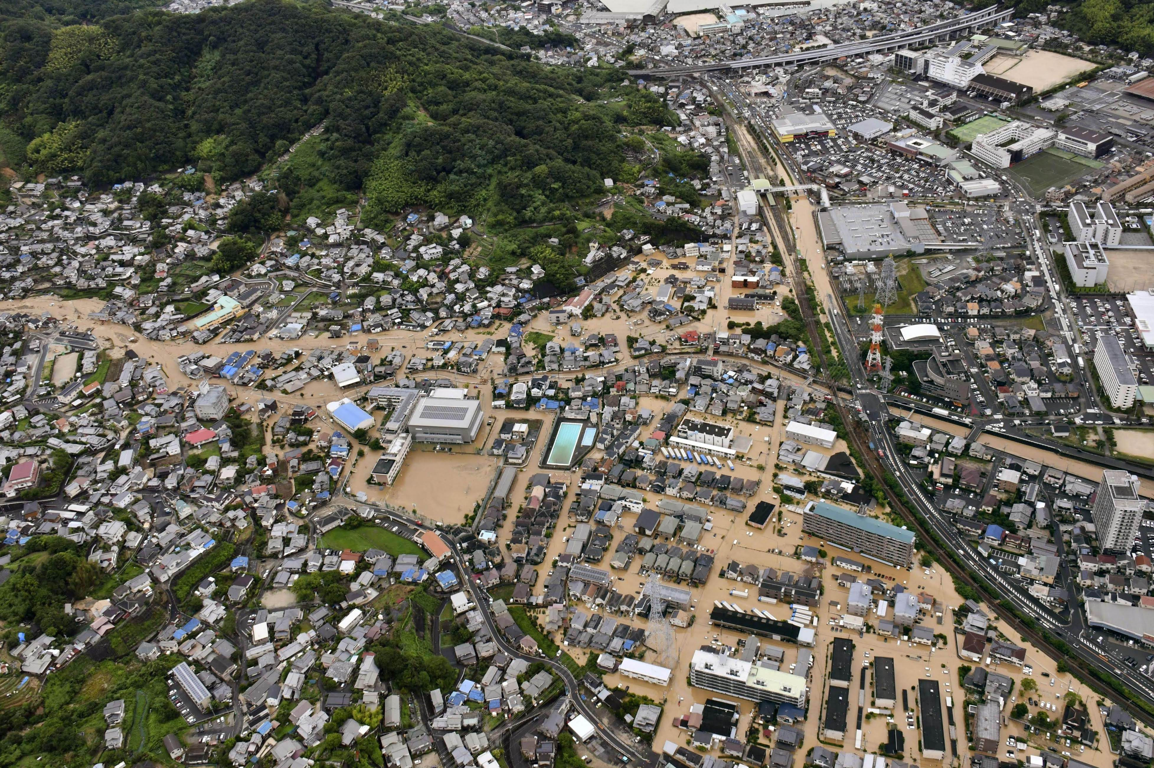 The town of Saka, Hiroshima Prefecture, is flooded in this photo taken from a Kyodo News helicopter Saturday morning.