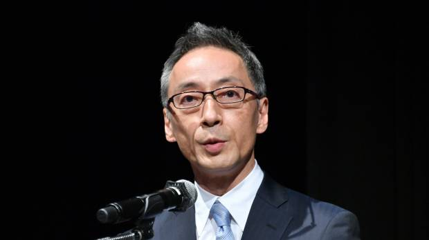 Marui Group Co. President Hiroshi Aoi delivers his keynote speech at a symposium in Tokyo on May 22.