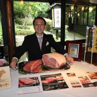 Tottori Gov. Shinji Hirai with blocks of premium Tottori Wagyu during an interview at Seisen-tei restaurant at Hotel New Otani Tokyo on June 17.