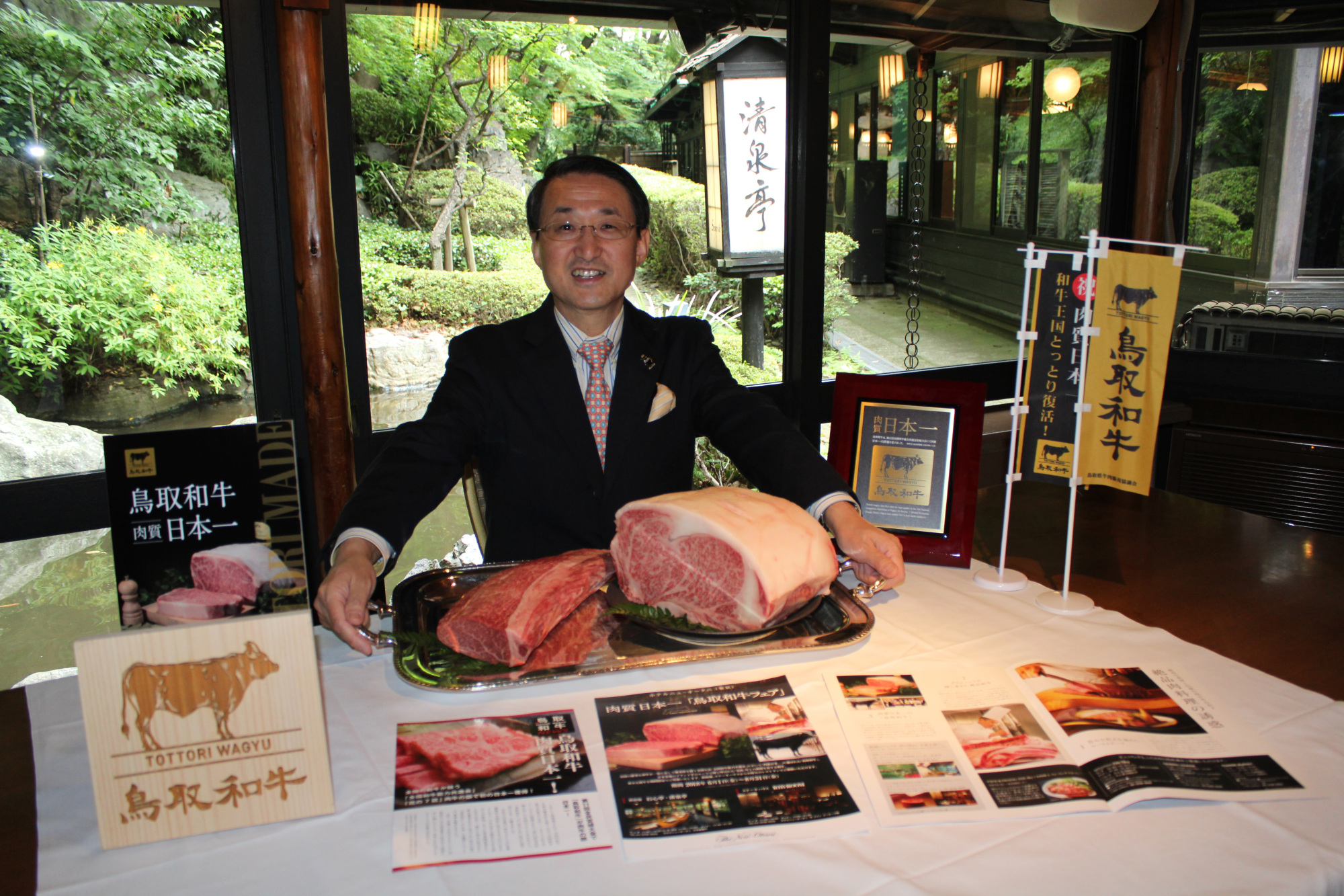 Tottori Gov. Shinji Hirai with blocks of premium Tottori Wagyu during an interview at Seisen-tei restaurant at Hotel New Otani Tokyo on June 17. | MASAAKI KAMEDA