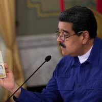Maduro move to lop five zeroes off currency, instead of three, worries Venezuelans