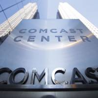 The Comcast Center in Philadelphia is seen last year. Comcast says it's dropping out of the bidding war for Twenty-First Century Fox's entertainment business, instead focusing on its bid for Sky. | AP