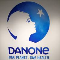 The logo of French food group Danone is pictured during the company's 2017 annual results in Paris in February. | REUTERS