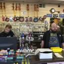 """James Murphy (left) and Bryan Knoche work the counter at Fred's Key Shop in Midtown Detroit July 11. Five years after Detroit filed for the largest municipal bankruptcy in U.S. history, Knoche says the small, family-owned locksmith business is """"busier than ever"""" because more people are moving into the area."""