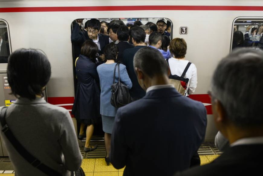 Tokyo wants people to go to work earlier to ease train crush