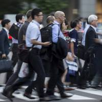 The labor market remained tight in June, with an uptick in unemployment blamed on people quitting jobs to find  better positions. | BLOOMBERG
