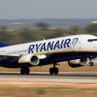 A Ryanair jet takes off from the airport in Palma de Mallorca, Spain Sunday. | REUTERS