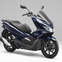 Honda Motor Co. says it will launch the PCX Hybrid scooter in Thailand in August. | KYODO