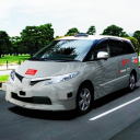 A self-driving taxi to be used in the upcoming tests in central Tokyo is shown in a computer-rendered image.