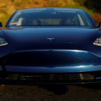 A 2018 Tesla Model 3 electric vehicle is shown in this photo illustration taken in Cardiff, California, June 1. | REUTERS