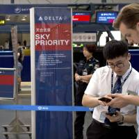 U.S. airlines to yield to Beijing's demands, will refer to 'China Taiwan'