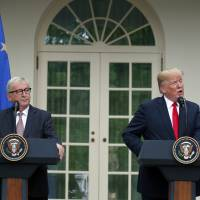Trump and EU chief Jean-Claude Juncker agree to ease trade tensions