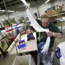 Barry Brown works at the Dunlap Industries facility in Dunlap, Tennessee, in May. The small zipper-making company is fighting to keep its pared-down staff occupied after it lost federal contracts to provide zippers for military uniforms.