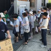Peace Winds Japan volunteers distribute water in an afflicted area. | COURTESY OF PEACE WINDS JAPAN
