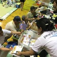 Peace Winds Japan volunteers distribute food at a shelter.  | COURTESY OF PEACE WINDS JAPAN