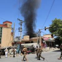 Eleven die in Afghanistan bus bombing; militants kill 4 in the east