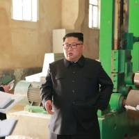 North Korean leader Kim Jong Un visits the Sinuiju Chemical Fiber Mill in this undated photo released Monday. | AFP-JIJI