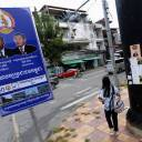 Posters for the Cambodian People's Party, headed by Prime Minister Hun Sen, and the FUNCINPEC Party are seen along a street in Phnom Penh on July 17.