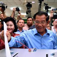 Cambodian leader's party claims all election seats as opposition sees 'death of democracy'