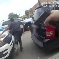Harith Augustus, 37, fatally shot by police, is seen fleeing from Chicago police in this still image from police body camera video footage taken in Chicago Saturday and released on Sunday. | CHICAGO POLICE DEPARTMENT COURTESY CHICAGO POLICE DEPARTMENT / HANDOUT / VIA REUTERS