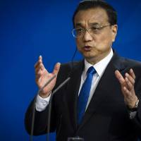 China hears rumbles of company discontent in rare open session
