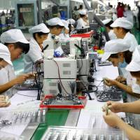 China GDP growth cools in second quarter as factory output weakens and trade row flares