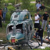 Pilot 'steered helicopter from crowds' before Beijing crash