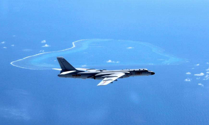 In this undated photo, a Chinese H-6K heavy bomber is seen on patrol over the South China Sea. | AP