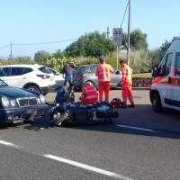 Ambulance personnel tend to a man lying on the ground, later identified as actor George Clooney, after he was involved in a scooter accident near Olbia, on the Sardinia island, Italy, Tuesday. | AP
