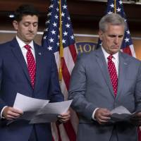 Speaker of the House Paul Ryan, R-Wis. (left) and Majority Leader Kevin McCarthy, R-Calif., review papers before answering questions from reporters on Capitol Hill in Washington Tuesday. Responding to criticism about President Donald Trump and his Helsinki news conference with Russian President Vladimir Putin, Ryan said there should be no doubt that Russia interfered in the 2016 presidential election. | AP