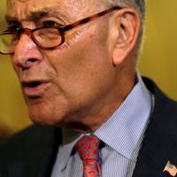 U.S. Senate Minority Leader Chuck Schumer (D-NY) speaks to reporters at the Capitol as fallout continued over U.S. President Donald Trump's Helsinki summit with Russian President Vladimir Putin, in Washington Tuesday. | REUTERS