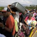 Venezuelans cross the International Simon Bolivar bridge into Colombia in February. The United States Agency for International Development Administrator Mark Green announced on Monday that the U.S. is pledging an additional $6 million in aid to help Colombia respond to the massive influx of Venezuelans fleeing their country's economic and humanitarian crisis.