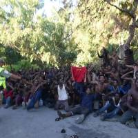 African migrants react in this still image from video after crossing the border from Morocco to Spain's North African enclave of Ceuta Thursday. | FARO TV / REUTERS TV / VIA REUTERS