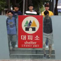 A shelter sign is displayed in the case of a possible North Korean attacks at the entrance to a subway station in Seoul Tuesday. | AP