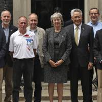 British divers in Thai cave rescue feted at Downing Street